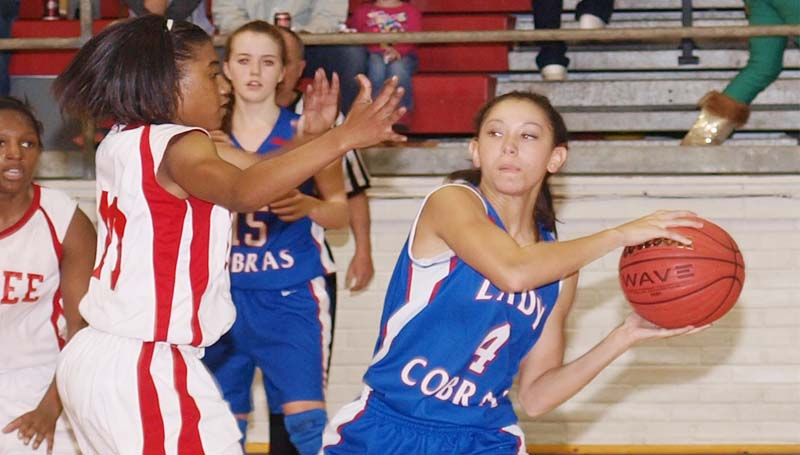 DAILY LEADER / TRACY FISCHER / Wesson Brandi McInnis (4) looks for help from her teammates as Magee's defender KeAsia Grey (10) applies pressure Friday night.