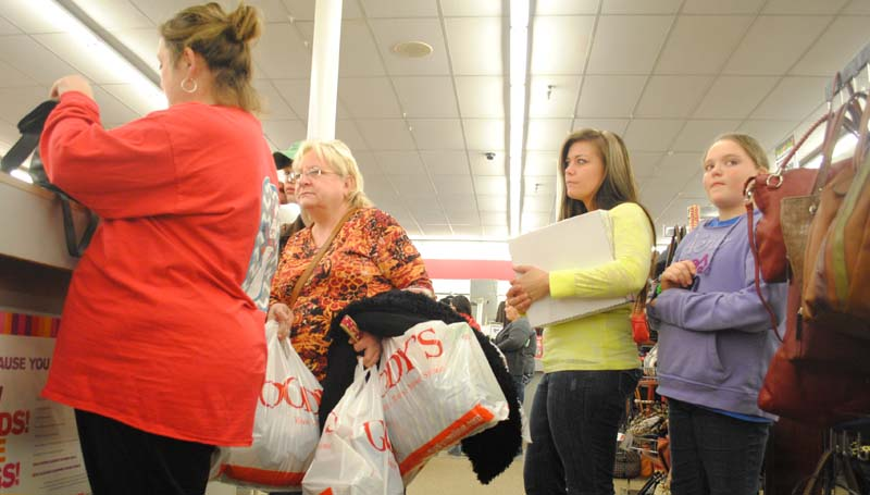 THE DAILY LEADER / JUSTIN VICORY / Leanne McCaffery (from left), Seth McCaffery, Debbie Querns, Melissa Morgan and Heidi Smith get a jump start on Black Friday shopping at Goody's Thursday night.