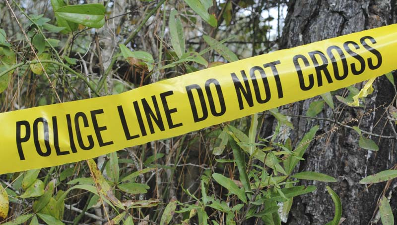 DAILY LEADER FILE PHOTO / Crime scene tape marks the location where a McComb man's burned body was found Oct. 30.