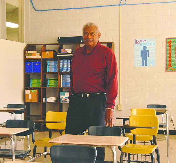 Pap Henderson was a student at Alexander High School when he learned of President Kennedy's death. He is shown here in a classroom in that building, which is now used as the Brookhaven's junior high school.