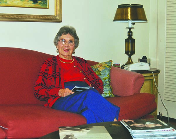 Phyllis Spearman sits in the room of her home on Church Street where she heard the news of the President's assassination on her radio.