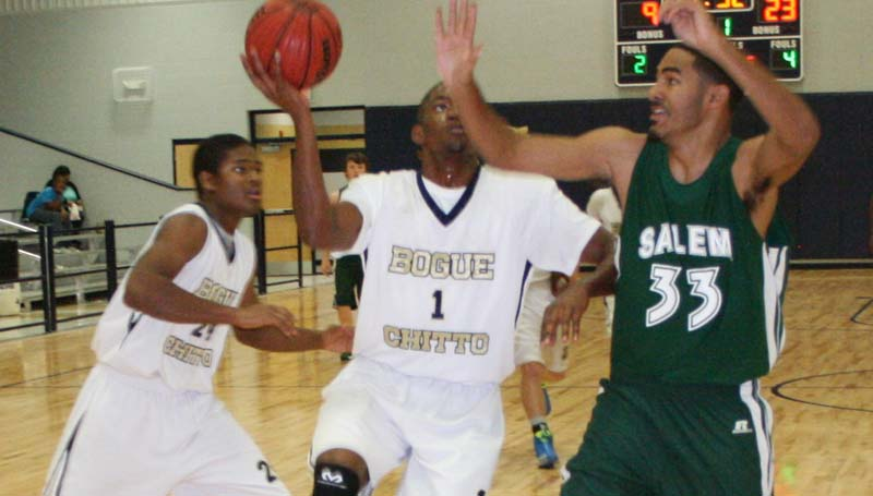 DAILY LEADER / MARTY ALBRIGHT / Bogue Chitto's senior forward Dennis Rogers prepares to go up for a layup as Salem's Donovan Peters hustle in to deny the play Thursday night in Bogue Chitto's new gym.