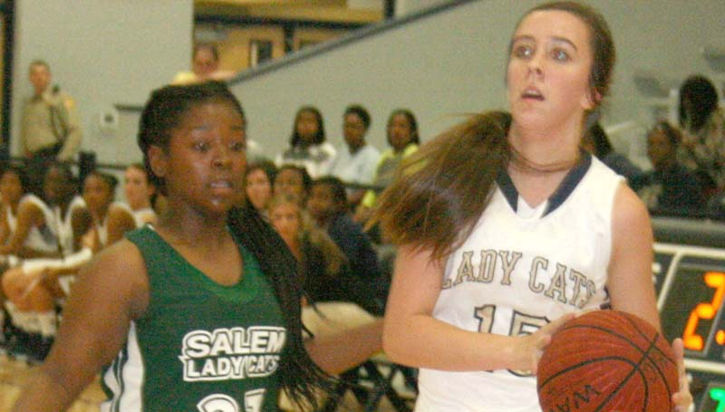 DAILY LEADER / MARTY ALBRIGHT / Bogue Chitto's guard Karlie Williams (15) drives past Salem's defender Zoie Bridges (23) Thursday night.