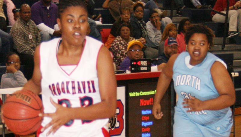 DAILY LEADER / MARTY ALBRIGHT /  Brookhaven's Diamond Herring (32) hits a game-winning free throw to help the Lady Panthers edge North Pike.