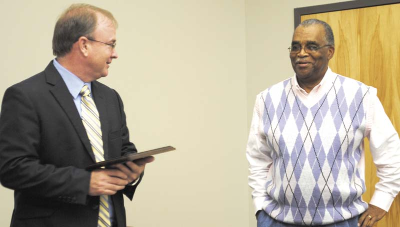 DAILY LEADER / JUSTIN VICORYDr. Ronnie Nettles, president of Copiah-Lincoln Community College, congratulates Andrew Spiller on five years of service on the Board of Trustees of the college. Spiller announced his retirement from the board at Thursday's board meeting.