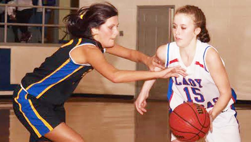 DAILY LEADER / TRACY FISCHER / Wesson guard Kayla Britt (15) handles the pressure of Sumrall's Olyvia Boutwell (13) Friday night.