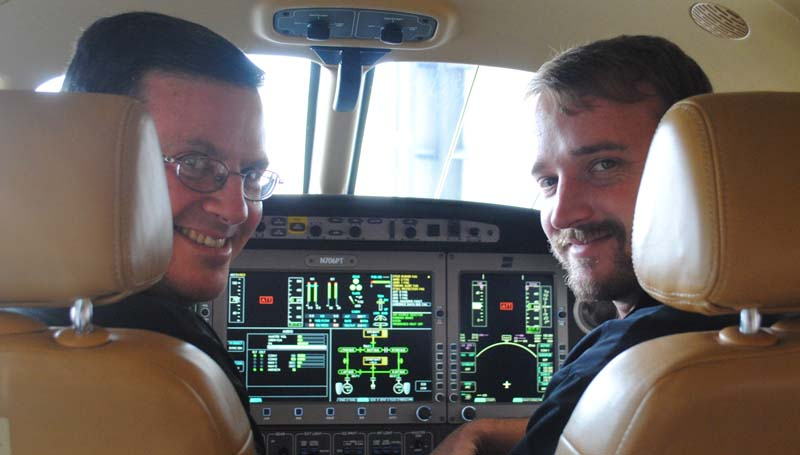 THE DAILY LEADER / JUSTIN VICORY / Randy Ferrell and Reade Taylor, both of Executive Air Charter, sit in the cockpit of one of their planes at the Brookhaven-Lincoln County Airport.
