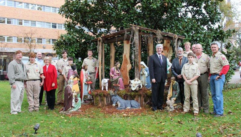 PHOTO SUBMITTED / A manger scene by Brookhaven Boy Scouts Troop 119 will be on display during the holiday season through the end of December in front of the Governor's Mansion in Jackson. Pictured are (from left) Greg Howell, Luke Howell, Mark Allen, state First Lady Deborah Bryant, Currie Allen, Charles David Nash, Andrew Knott, Clayton Roberts, Gov. Phil Bryant, Lester Powell, Tyler Hosick, Eric Hosick, Ben Doty, Joe Fernald and Rollin Roberts.