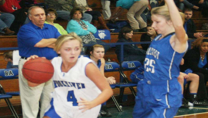 DAILY LEADER / MARTY ALBRIGHT / Brookhaven Academy's Hillary Wilson (4) drives past an Hillcrest defender Tuesday night.