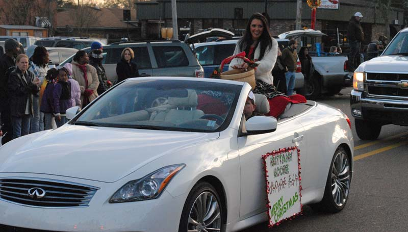 THE DAILY LEADER / JUSTIN VICORY / Wesson High School Sophomore Beauty Brittany Moore gets ready to toss out candy Tuesday afternoon at the Wesson Christmas Parade.