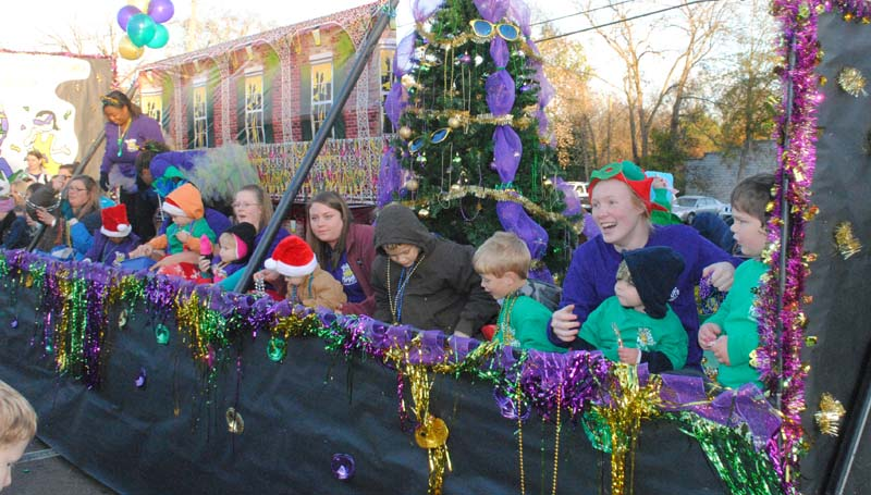 THE DAILY LEADER / JUSTIN VICORY / Mardi Gras colors of green, purple and gold found a way to complement red and green in the Precious Moments Learning Center float. For additional photographs of the parade, please see page 12.