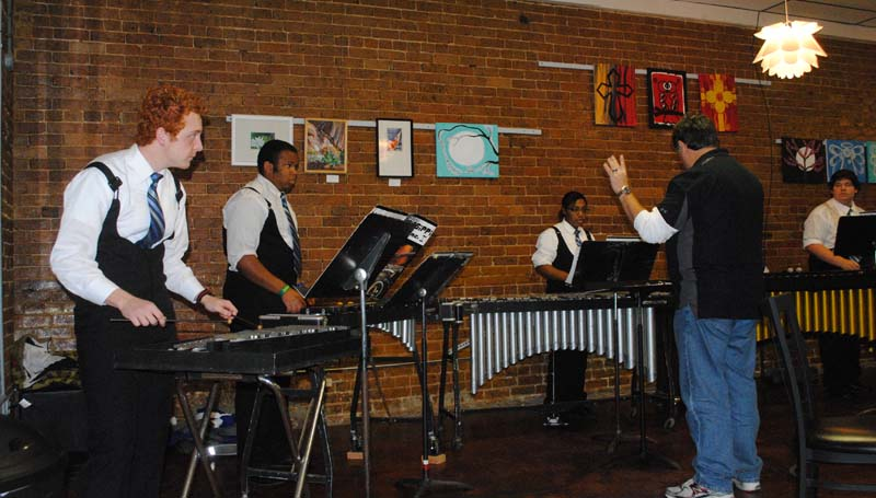 Members of the Copiah-Lincoln Community College percussion ensemble perform Christmas songs inside the cozy confines of Polly Wogs in downtown Wesson after the parade. Musicians include (from left) Taylor Watson, Chris Samuels, Tisha McGee, Carson Smith and Instructor Michael Brothers.