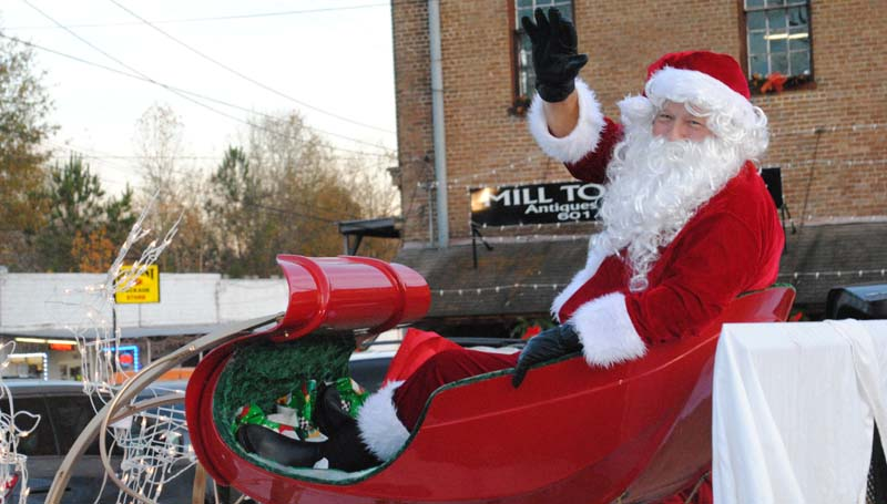 THE DAILY LEADER / JUSTIN VICORY / Riding in his sleigh, Santa Clause waves to the crowd gathered along Highway 51 in downtown Wesson for the town's annual Christmas Parade Tuesday afternoon.