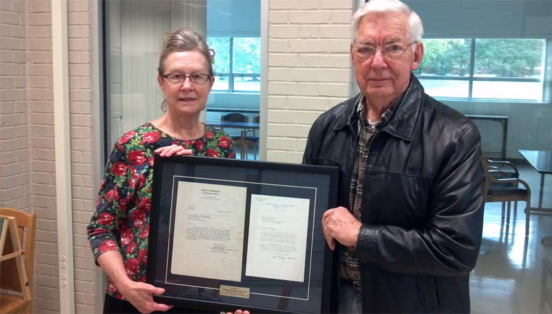 """PHOTO SUBMITTED / Bea Teasley of the Lincoln County Public Library, (from left) and Charley Evans hold two historical letters on loan to the library from Evans. The letters, dating back to 1935 and 1936, are commendations to the National Automobile Theft Bureau. The 1935 letter is from the U.S. Department of Justice Investigations Division, and the 1936 letter is from the then newly formed Federal Bureau of Investigation. One letter extends thanks for assistance rendered in the investigation of notorious criminals John Dillinger and """"Baby Face"""" Nelson. The other is a personal letter from then-FBI director J. Edgar Hoover. Evans retired and returned to Brookhaven after serving the NATB for 30 years."""