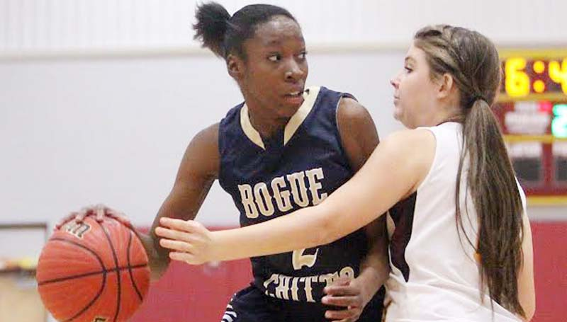 DAILY LEADER / JONATHON ALFORD / Bogue Chitto's Zariah Matthews (2) tries to protect the ball as Enterprise defender Courtney Greer reaches to knock the ball away Thursday night in Lincoln County tournament action.