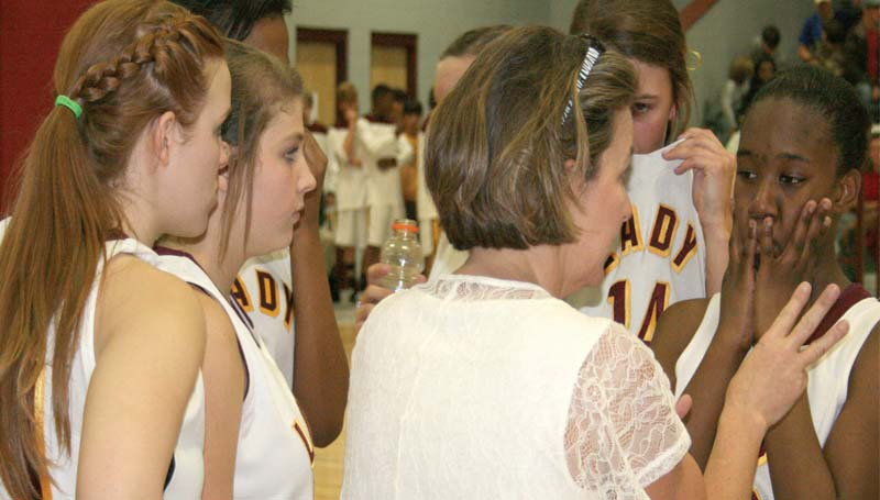 DAILY LEADER / MARTY ALBRIGHT / Enterprise coach Jill Nations speaks to her Lady Jackets during a timeout in the closing seconds of the fourth quarter against Loyd Star Friday night in the Lincoln County Tournament.