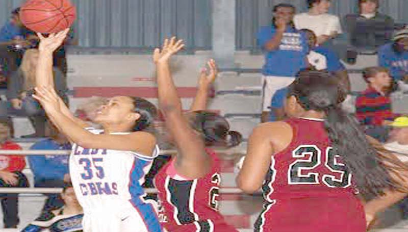 DAILY LEADER / TRACY FISCHER / Wesson's LaCatherine Hence (35) glides through the line to put the Lady Cobras ahead as Germantown's Lenesha Allen (21) tries to deny the shot Saturday night at the Snake Pit.