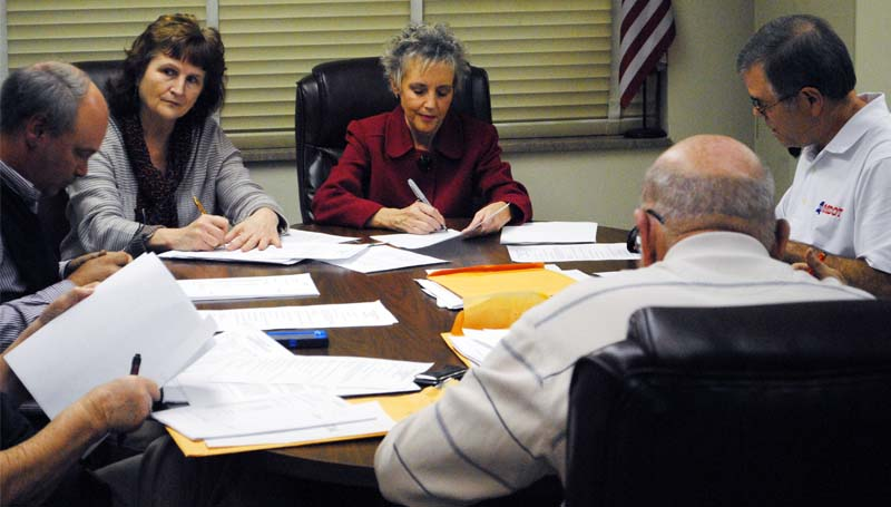THE DAILY LEADER / RHONDA DUNAWAY / Assistant Superintendent Letha Presley (center) approves the districts financial statements at Monday's meeting with board president Ricky Welch (from left), administrative director Regina East, and board secretary John Hart.