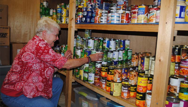 THE DAILY LEADER / JUSTIN VICORY / Gwen Dyess, chairman of the food pantry at Union Hall Baptist Church, organizes food items in preparation for Christmas.