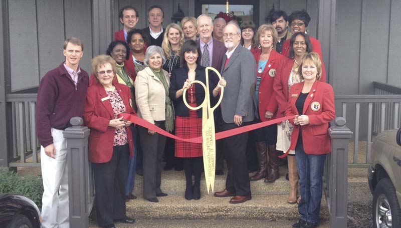 PHOTO SUBMITTED / Shelley Harrigill (center with scissors), attorney at law, held an official ribbon cutting recently to celebrate the opening of her new office, located on Brookway Boulevard. Members of Harrigill's family and staff include her mom, Hilda Harrigill (from left of Shelley), who is a Notary Public and office assistant, Harrigill's dad, Donald Harrigill, and Danny Robinson, office assistant. Also on hand for the ribbon cutting were members of the Brookhaven-Lincoln County Chamber of Commerce.