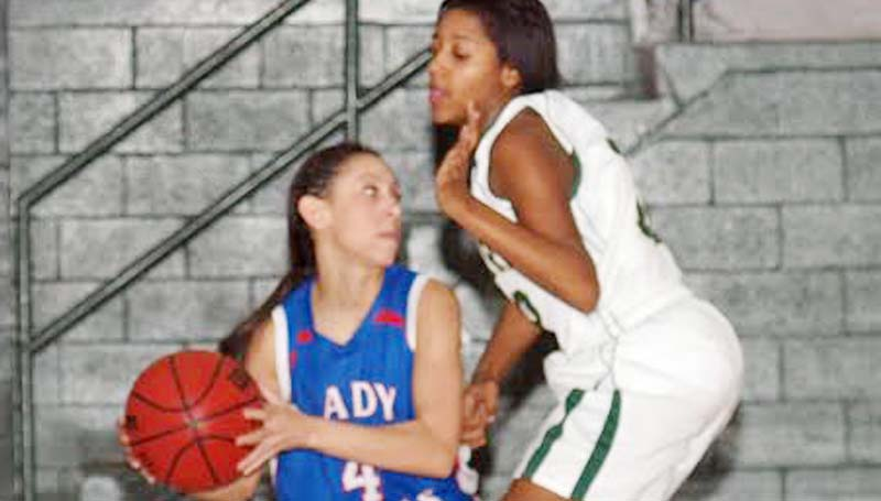 DAILY LEADER / TRACY FISCHER / Wesson senior guard Brandi McInnis (4) looks for some help as McLaurin's defender Kaylain Smith applies pressure Friday night.