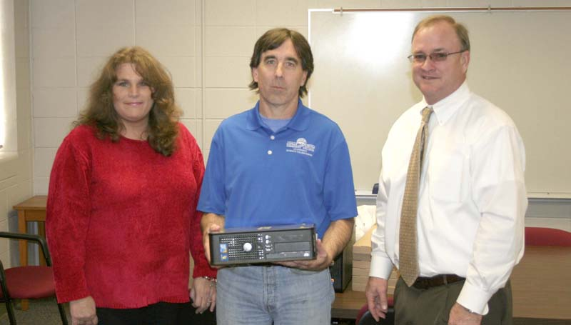 PHOTO SUBMITTED / Tammy Reid Thames (left), IT manager for Georgia-Pacific Monticello, delivers computers to Copiah-Lincoln Community College's Dr. Kevin McKone (center), chair of the Co-Lin science department, and Co-Lin president Dr. Ronnie Nettles (right).