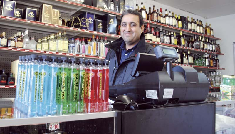 DAILY LEADER / JUSTIN VICORY / The the passage of a local option liquor referendum for the city in June led to the opening of five liquor stores in the city later in the year. Among the businesses was Star Liquor, operated by Narinder Singh, who waits for customers behind the counter at his store located at 701 E. Monticello last week.