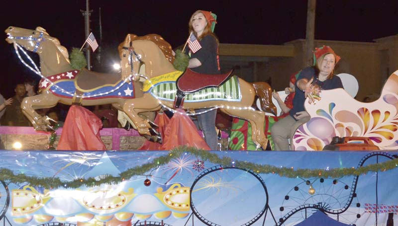 The Exchange Club's float, featuring live calliope music, the restored carousel horses and a moving merry-go-round, won the best children's theme category.
