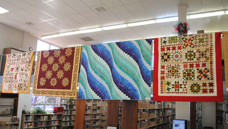 A wide selection of quilts of all sizes, styles and fabrics can be found draped over the second floor balcony of the library and in the library meeting room. The quilt show is being staged by the Brookhaven Regional Arts Guild and the local quilt guild.