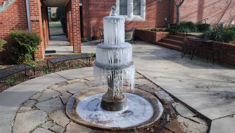 THE DAILY LEADER / JUSTIN VICORY / The plunging temperatures led to a frozen fountain at the Episcopal Church of the Redeemer Monday. Monday's low was 12 degrees, and the temperature was still reported at 13 degrees at 7:30 Tuesday morning.