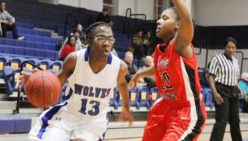 CO-LIN MEDIA / NATALIE DAVIS / Co-Lin's Ashley Minor (13) drives past Baton Rouge's Lanae Bickham (20) Tuesday night in womens' JUCO action at Mullen Gymnasium.