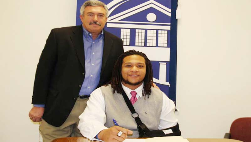 CO-LIN MEDIA / NATALIE DAVIS / JOHNSON SIGNS WITH MSU - Copiah-Lincoln Community College defensive lineman Jocquell Johnson of Jackson has signed with Mississippi State University. Johnson (6-5, 305) is the first Co-Lin player to sign with Mississippi State since 2007. In his two years at Co-Lin, the Wolfpack posted a 16-5 record, winning the MACJC State Championship in 2012. Pictured with Johnson is Co-Lin head coach Glenn Davis.