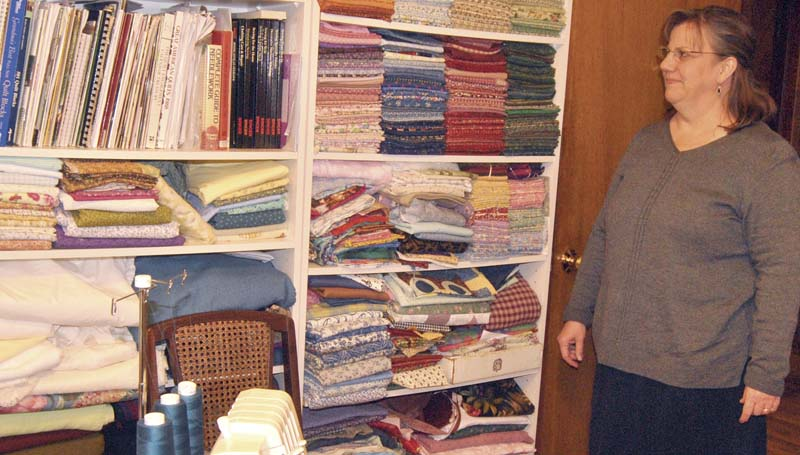 "DAILY LEADER / KIM HENDERSON / Renee Naeger likes using shelves to organize her quilting fabrics. ""This way, it's there all the time. If I have a project in mind, the pieces I have to work with are right there at my fingertips."""