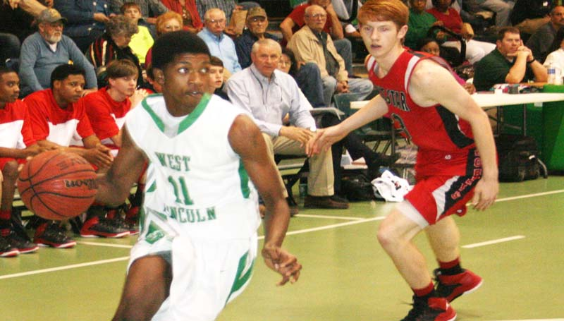 DAILY LEADER / MARTY ALBRIGHT / West Lincoln's Keshaun London (11) dribbles past Loyd Star's Levi Redd (23) Tuesday night in Jack Case Gymnasium.