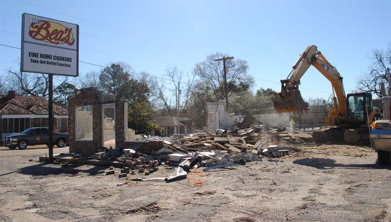 THE DAILY LEADER / JUSTIN VICORY / A bulldozer rips into the former site of Ms. Bea's diner on East Monticello Street Wednesday morning, leaving a pile of rubble in its wake as the site was cleared. Information on the future of the lot was not available.