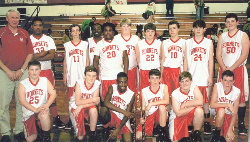 DAILY LEADER / SUBMITTED / The Loyd Star Hornets captured their third straight junior high basketball conference crown and finished the season with an 11-1 record. Representing the Hornets are (from left, kneeling) Rials Hester, Cullen Keene, Patrick Price, Cade Hodges, Clay Smith, Dane Smith; (back row) Coach Gene 'Moochie' Britt, Terrance Fields, Jett Calcote, Zaycheous Vaughn, Zabien Price, Cam Harveston, Braden Ezell, Brent Cade, Micah Calcote and Gage Netterville.