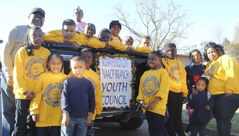 DAILY LEADER / JUSTIN VICORY / Members of the Brookhaven-Lincoln County NAACP Branch Youth Council take a  timeout from rolling down the streets of Brookhaven Sunday afternoon as part of a parade in honor of Martin Luther King Jr. Day.