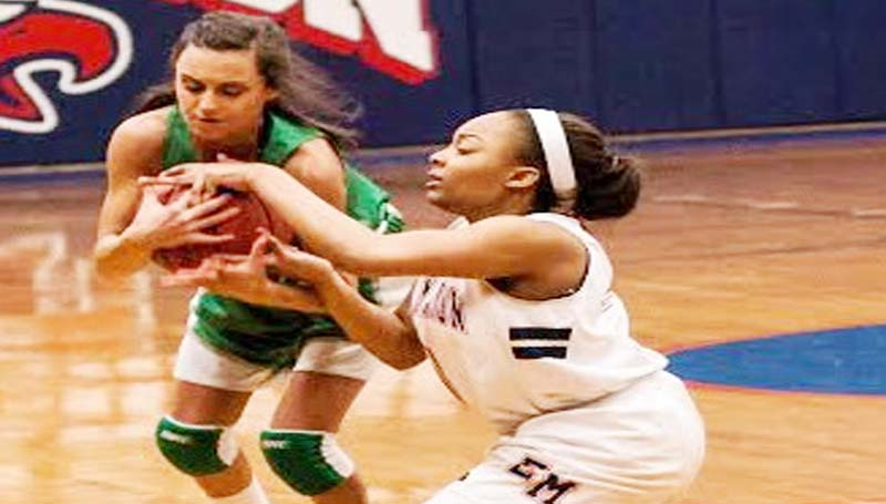 """DAILY LEADER / TERESA ALLRED / West Lincoln guard Karley """"Squishy"""" Smith fights for the loose ball against an East Marion defender Friday night in Columbia."""