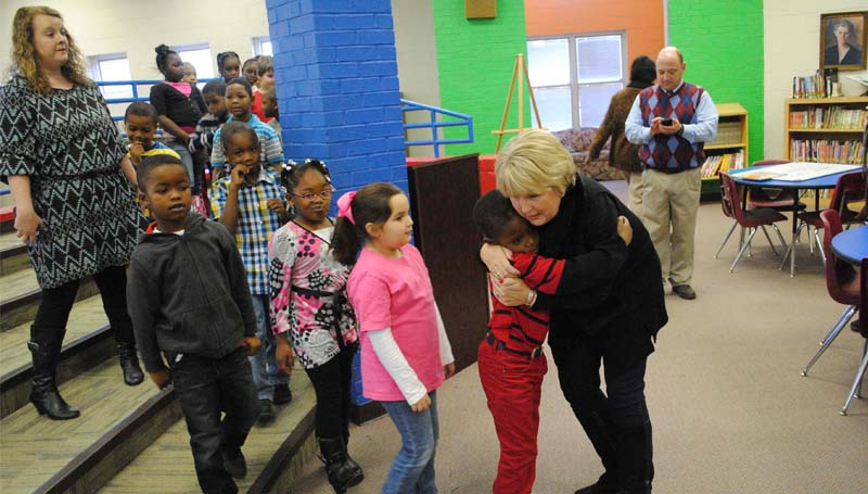 "DAILY LEADER / RHONDA DUNAWAY / Mississippi's First Lady Deborah Bryant was in Brookhaven Wednesday reading to first-graders at Mamie Martin Elementary Library. Corday Peyton gives the first lady a hug (above) while Gracie Boswell, Brooklyn Givens, Gerald Gallaway and Markel Smith wait their turn to greet the governor's wife. Bryant wants to help ensure that all Mississippi children get a comprehensive education that will prepare them to be successful adults. For 2014 she will ""Read Across Mississippi"" to students (K-3) in all Mississippi counties. ""I decided this year that I would read to kids in every county of Mississippi,"" she said. Bryant was heading to Wesson Wednesday for her next reading."