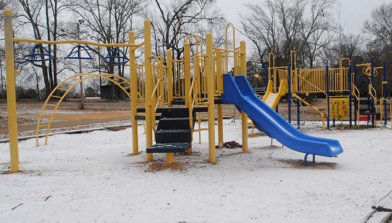 THE DAILY LEADER / JUSTIN VICORY / Like much of the area, the playground at Exchange Park was carpeted with a thin layer of snow Friday morning.