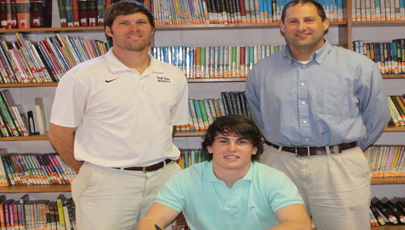 DAILY LEADER / PHOTO SUBMITTED / Loyd Star outfielder Seth Farmer has signed a letter of intent to play baseball for the Pearl River Community College Wildcats next year. Pictured with Seth are (from left) Loyd Star coaches Jared Britt and Jonathan Breakfield.