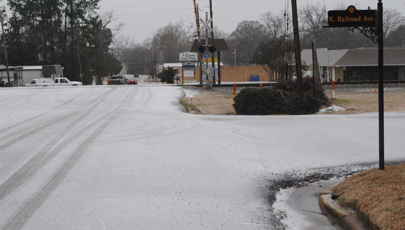 THE DAILY LEADER / JUSTIN VICORY / As sleet falls in the area Tuesday morning, an icy coating blankets the intersection of North Railroad Ave. and East Court St. Tuesday morning.