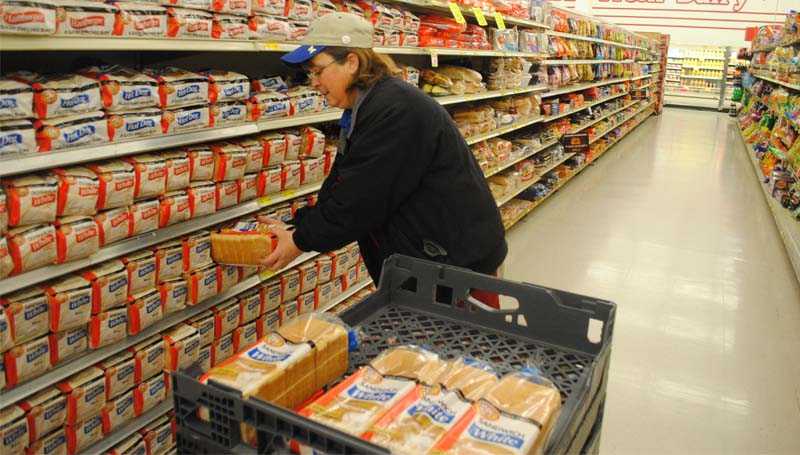 THE DAILY LEADER / JUSTIN VICORY / Meanwhile, Debra Harper makes a point of over-stocking bread early Tuesday morning in anticipation of high shopping volumes due to the icy weather. Many area residents are loading up on necessary supplies. Lincoln County and the surrounding area are under a winter storm warning in effect until 6 p.m. this evening, and the chance of winter precipitation is 90 percent.