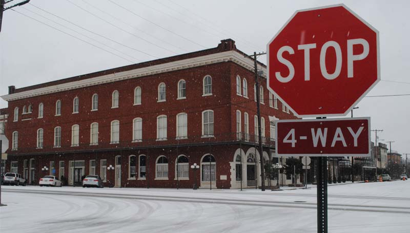 By midday Tuesday, the intersection of Railroad Avenue and East Monticello Street was coated in frozen precipitation with nary a car moving as travelers stayed off the slippery streets.