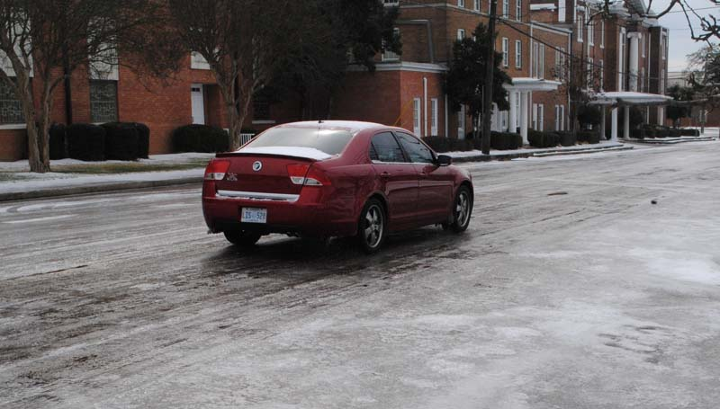 THE DAILY LEADER / JUSTIN VICORY / A motorist drives very slowly on First Street Wednesday morning due to the extremely icy conditions.