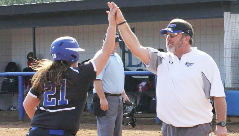 CO-LIN MEDIA / NATALIE DAVIS / Co-Lin head coach Allen Kent gives a high-five to Breanna McKenzie (21) after she slugged a grand slam. McKenzie, a North Pike product, had five hits and five RBIs in her debut.