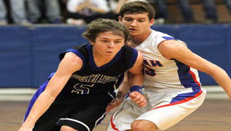 DAILY LEADER / SHERYLYN EVANS / Brookhaven Academy's Zach Smith (5) drives past Copiah's defender Trey Moss (13) Monday night in MAIS basketball action.