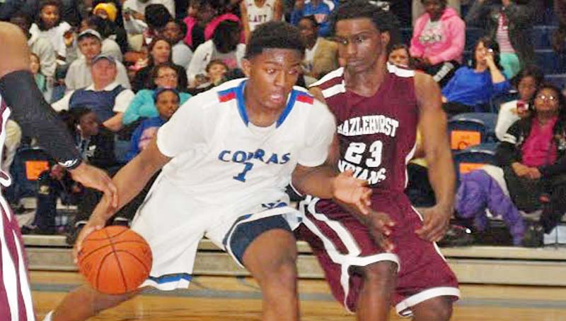 DAILY LEADER / TRACY FISCHER / Wesson Farrod Green (1) drives past Hazlehurst's Reginald Jones (23) Tuesday night.