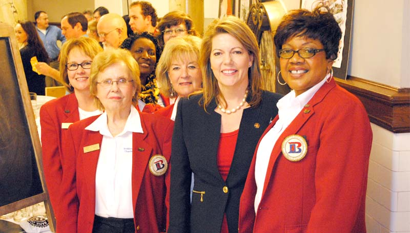 """THE DAILY LEADER / OTIS RAYBON / Brookhaven-Lincoln Chamber of Commerce ambassadors (from left) Sheila Burd, Catherine Dickey, Imogene Ryan and (far right) Brenda Henderson are greeted by state Sen. Sally Doty, R-Brookhaven (second from right) at the state capitol at Tuesday's Brookhaven Day at the Capitol. Marketing director for the Brookhaven-Lincoln County Chamber of Commerce Kay Burton (not pictured), who  was also at the capitol event, said the special day is designed to promote Brookhaven as a great place to call home and a potential site for industry. """"We are there also to keep the interests of Lincoln County and Brookhaven, or even southwest Mississippi - we go up there for good will, but we also leave a good impression of our town and our area, and leave an impression on the legislators of what is important to the people in our community."""" (Please see related photos on page 3.)"""