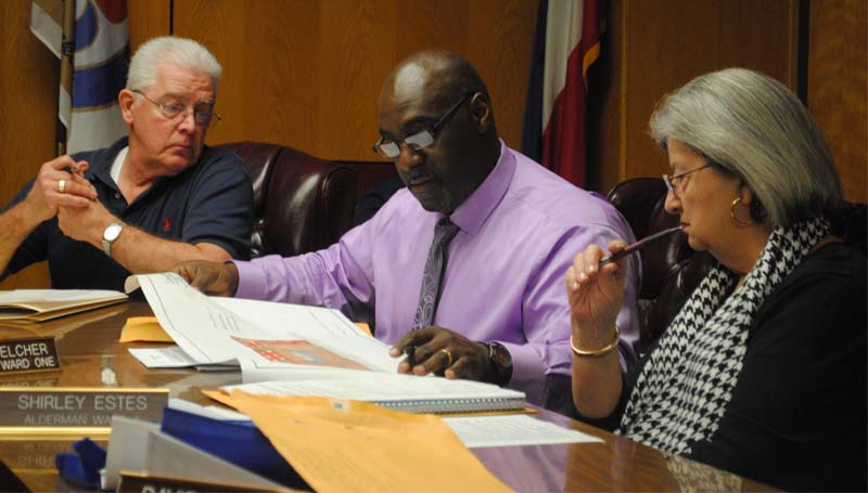 THE DAILY LEADER / JUSTIN VICORY / City Clerk Michael Jinks (from left), Ward One Alderman Randy Belcher and Ward Four Alderman Shirley Estes examine a proposal from a local veterans' group Tuesday night.